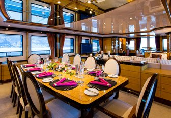 formal dining area in the main salon aboard charter yacht DIANE