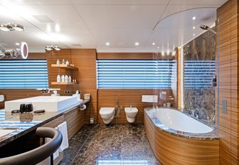 luxurious bathroom in master suite aboard superyacht 'Silver Fast'