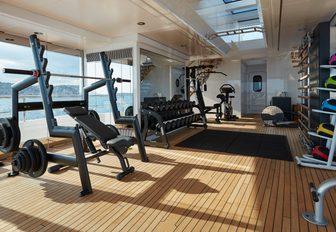 glass-enclosed gym with Technogym equipment on board luxury yacht JOY