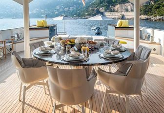 circular alfresco dining table on the main deck aft of expedition yacht ZULU