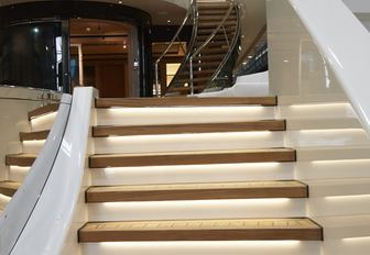 An illuminated staircase fitted to superyacht HASNA