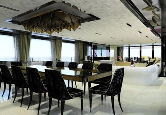 bright and open main salon with formal dining on board charter yacht SARASTAR