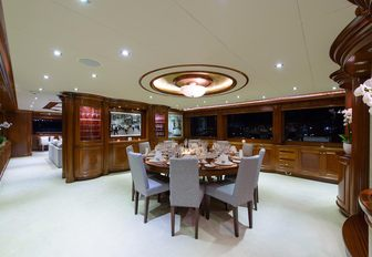 circular dining table in the main salon of motor yacht Far From It