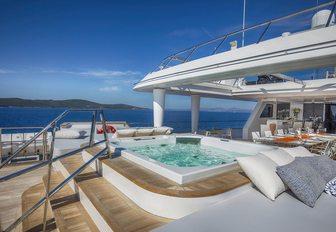 step-up Jacuzzi on the sundeck of luxury yacht KATINA