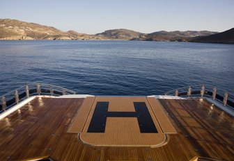 wide shot of glass bottom swimming pool of charter yacht Alfa Nero whose platform has been raised to turn the space into a helipad