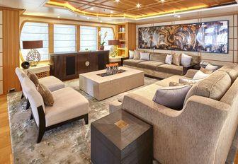 stylish main salon with modern art aboard charter yacht HANIKON