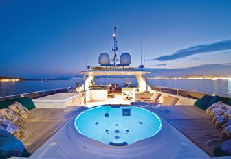 The sundeck and Jacuzzi on board M/Y One Last Toy