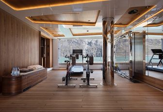 Cycling machines and a treadmill looking out to sea from the beach club of superyacht CLOUDBREAK