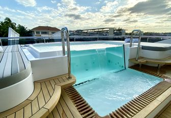pool on sundeck of superyacht babas during bahamas charter show as seen in bay street marina
