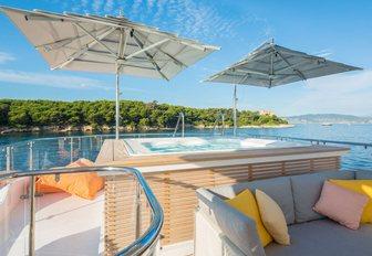 Spa pool under umbrellas on the sundeck of motor yacht DYNAR