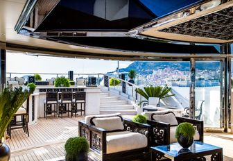 glimpse of the raised pool area from the atrium on the sundeck aboard motor yacht 'Lioness V'