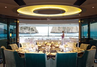 semi-alfresco dining setup on board charter yacht QUITE ESSENTIAL