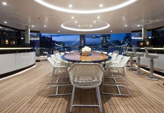 semi-alfresco dining area alongside bar on the upper deck aft of charter yacht KISMET
