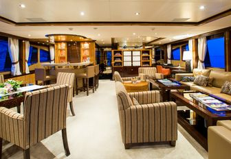 skylounge aboard motor yacht DIANE with ample seating, games table and bar