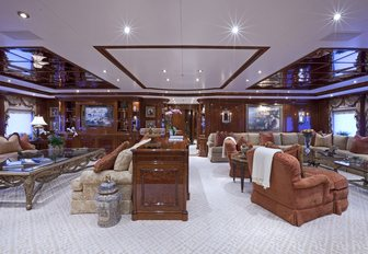 classically-styled main salon with large seating areas on board charter yacht Martha Ann