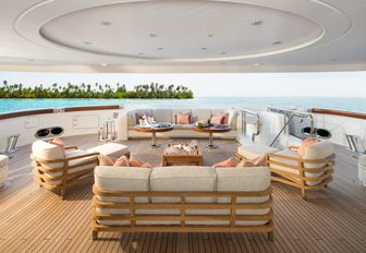 aft deck seating area with sofas and armchairs on board motor yacht CALYPSO