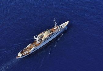 Aerial shot of luxury superyacht Christina O sailing deep blue water