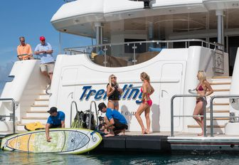 guests on the swim platform of charter yacht TRENDING as crew members launch the water toys
