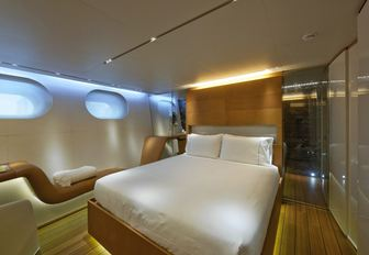 owners cabin with porthole windows and discreet lighting on sailing charter yacht panthalassa