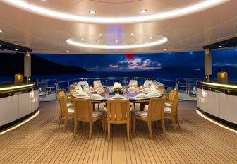alfresco dining area at night on board superyacht KISMET