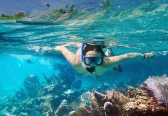 charter guest aboard charter yacht 'Chasing Daylight' snorkels in Baja Peninsula