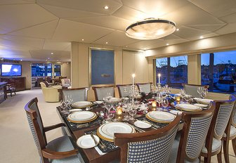formal dining area in the main salon of motor yacht Sweet Escape