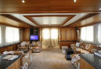 Main salon with comfortable sofas and TV on motor yacht DARDENELLA