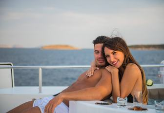 Sundeck jacuzzi on motor yacht ANDREA, with man and woman enjoying the ambience