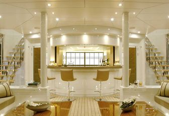 the ethereal and golden upper lounge inside charter yacht siren is spectacular and luxurious providing her guests with a wonderful place to take selfies and unwind while they self isolate on their luxury yacht charter vacation in Croatia