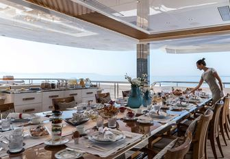 Tables set on outdoor deck of Superyacht LANA