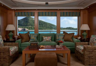 comfy seating in green fabrics aboard luxury yacht OASIS