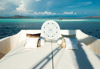 oversized sunbeds on deck of sailing yacht ALEXA