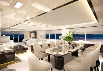 dining table and lounge in the main salon of charter yacht O'Mathilde