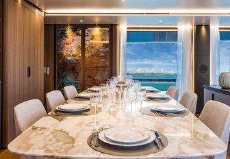 formal dining area in the main salon aboard charter yacht Vista Blue