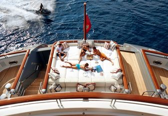 charter guests relax on sun pads aboard superyacht TV