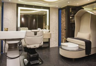 The white hairdressing chair and basins on board superyacht KISMET