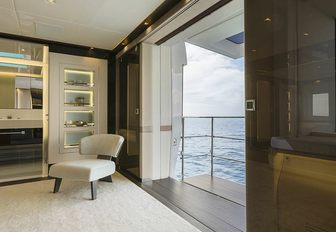 the balcony of charter yacht EVA. 4EVA with plush lounging chair