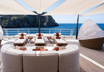 loungers and cabanas on the sundeck of motor yacht 'Here Comes The Sun'