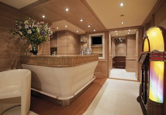 limed oak bar and jukebox in the skylounge of superyacht JO