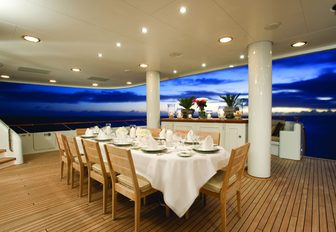 alfresco dining area set for dinner aboard charter yacht UTOPIA