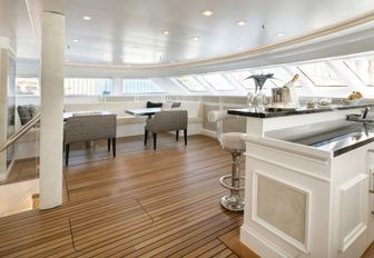 enclosed dining area with a bar on board charter yacht Spirit of the C's
