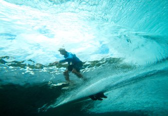 surfer catches a wave in Fiji