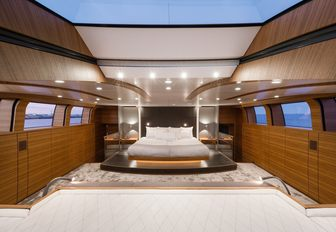 large bed in teak-clad master suite on board luxury yacht 'Silver Fast'