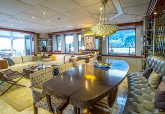 formal dining area in the main salon of charter yacht ZULU