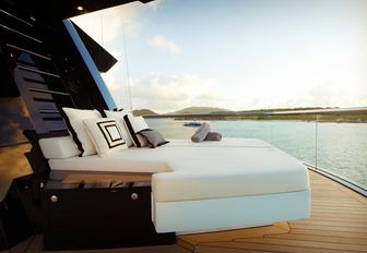 An outdoor bed featured on luxury yacht KISMET
