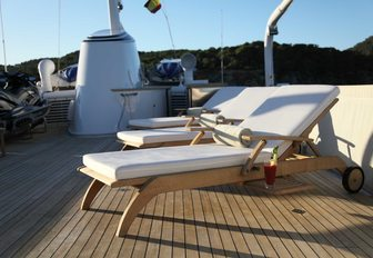 sun lounger with a cocktail on sundeck of charter yacht 'Heavenly Daze'