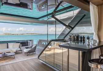 innovative doors and indoor-outdoor area on the main deck aft of motor yacht Vista Blue
