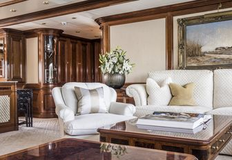 intimate lounging area in the bridge deck salon of charter yacht TITANIA