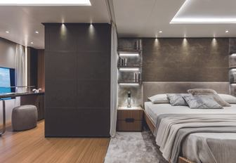 master suite with large bed on board superyacht Vista Blue