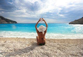 woman doing yoga on a beach in Lefkada, Greece
